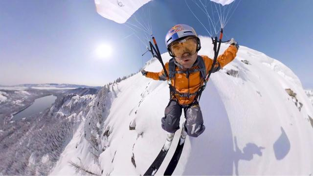 Man parachute skiing with a GoPro