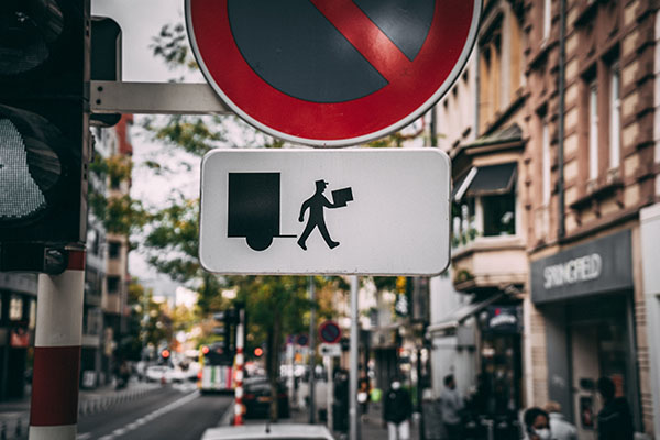 Delivery man on traffic sign